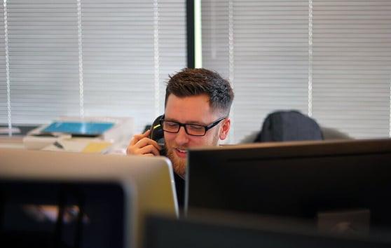 man-phone-call-office